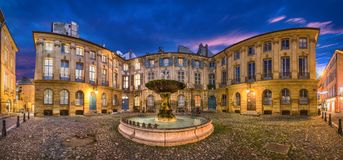 Aix-en-Provence, France. Panorama of Place D`Albertas at dusk. Aix-en-Provence, France. HDR panorama of Place D`Albertas square with old fountain at dusk royalty free stock photography