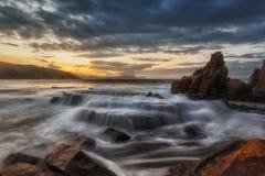 Aizkorri beach at sunset Stock Image