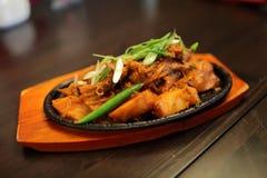 Ajab sandal dish. The ajab sandal dish on a cast-iron frying pan Stock Photo