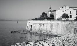 Ajaccio, citadel with white lighthouse tower. Corsica island, France. Monochrome photo Stock Photo