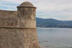 Ajaccio on Corsica island, France October 12 2017 - View on the tower of Citadel Miollis and the sea.  Royalty Free Stock Image