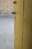 Ajar door. Ajar yellow door in old basement Royalty Free Stock Image