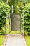 Ajar Gate. Gray Gate In After Rain Garden Summer. Ajar Gate. Old Painted Metal Gray Gate In After Rain Garden Summer Day Stock Image