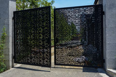 Ajar latticed steel gate of yard under consturction Royalty Free Stock Image