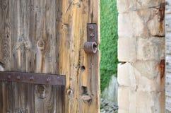 Ajar old castle door. Ajar old heavy wooden door of an old castle Royalty Free Stock Photo