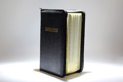 Ajar stands the Bible on a white background Royalty Free Stock Image