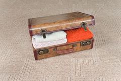 Ajar suitcase full of clothes Stock Image