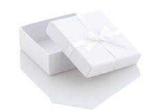 Ajar white gift box on a white background Royalty Free Stock Photos
