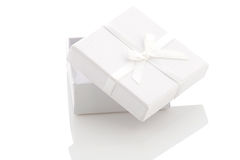 Ajar white gift box on a white background Royalty Free Stock Photo