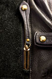 Ajar the zipper on a leather bag. Ajar the zipper on a black leather bag Stock Photo