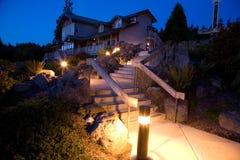 Ajardinar e arquitetura da noite Foto de Stock Royalty Free