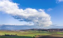 Ajardine com acre e o céu azul em Ronneburg Fotografia de Stock Royalty Free