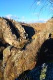 Ajardine com céu azul, desfiladeiro e sombra do fotógrafo Imagem de Stock Royalty Free