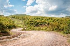 Ajardine com a trilha de carro nas montanhas, Turquia Foto de Stock Royalty Free