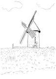 Ajardine com um moinho Fotografia de Stock