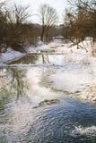 Ajardine com um rio derretido do gelo Imagens de Stock Royalty Free