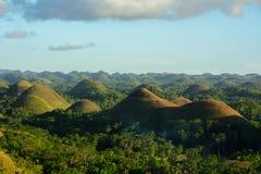 Ajardine em Filipinas, por do sol sobre os montes do chocolate na ilha de Bohol Imagens de Stock Royalty Free
