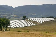 Ajardine en los marzos con los paneles solares Foto de archivo libre de regalías
