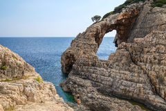 Ajardine a ideia de formações rochosas Korakonissi em Zakynthos Imagens de Stock