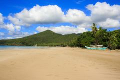 Ajardine la playa de Nacpan La isla de Palawan Foto de archivo libre de regalías