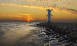 Ajardine o farol marinho na forma de um moinho de vento Fotografia de Stock