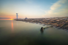 Ajardine o farol marinho na forma de um moinho de vento Fotos de Stock
