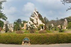 Ajardine o projeto em milhão anos de parque de pedra em Pattaya, Tailândia Fotografia de Stock Royalty Free