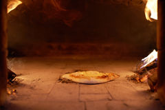 Ajarian khachapuri with cheese cooked in oven burning firewood. Stock Images