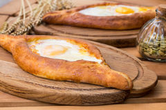 Ajarian khachapuri on wooden table. Traditional Georgian cuisine. cuisine of the Georgian people.  Royalty Free Stock Photos