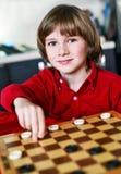 Ajedrez del juego del muchacho Imagen de archivo libre de regalías