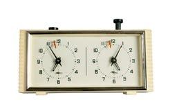 Ajedrez-reloj viejo aislado en el fondo blanco Imagen de archivo libre de regalías