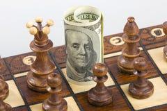 Ajedrez y dólar Fotografía de archivo