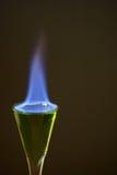 Ajenjo en el fuego en el vidrio Imagen de archivo libre de regalías