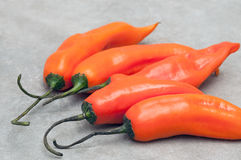Aji amarillo hot chili peppers on stone background royalty free stock image