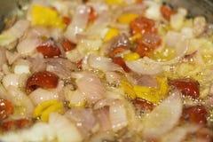 Aji Chilli Sauce - Peruvian chilli sauce preparation. Onion, garlic, rocoto, sunflower oil on a pan to be fried Stock Photos
