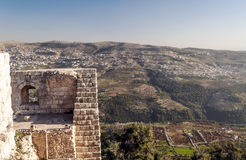 Ajloun castle in ruins. Is located in Jordan. You can see the houses of the village in one side  on a sunny day Royalty Free Stock Photos