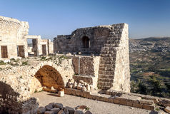 Ajloun castle in ruins. Is located in Jordan. You can see the houses of the village in one side  on a sunny day Stock Photo