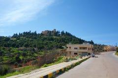 Ajloun slott, muslimsk slott som byggs av Ayyubidsen i det 12th århundradet som förstoras av Mamluksen, på en bergstopp som tillh arkivfoto