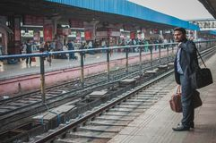 Waiting for the train anxiously. Ajmer, India : 18th February, 2015 - Shot of an Indian in formal attire waiting anxiously for the train to arrive Royalty Free Stock Photography