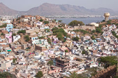 Ajmer in Rajasthan. The town of Ajmer in Rajasthan, India with the Aravalli hills and the large artificial lake Anasagar in the background. It is a pilgrimage Royalty Free Stock Images