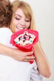 Ajouter à étreindre de fleurs de groupe de sucrerie Amour Photo libre de droits