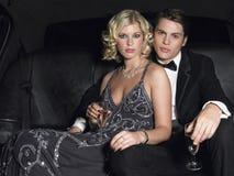 Ajouter à Champagne Flutes In Limo Photographie stock libre de droits