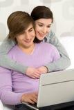 Ajouter à l'ordinateur portatif Photographie stock libre de droits