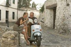 Ajouter à la carte de lecture de scooter à Grenade Photos libres de droits