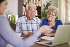 Ajouter aînés au conseiller financier Images libres de droits