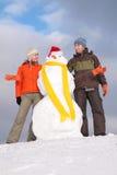 Ajouter au bonhomme de neige Photo stock