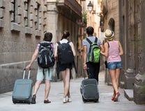 Ajouter aux bagages marchant la ville Photographie stock libre de droits