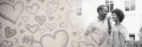 Ajouter aux coeurs et à la maison de transition de l'amour de la valentine Photographie stock