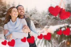Ajouter aux coeurs sur le fond de neige Photos libres de droits