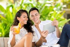 Ajouter de Balinese au PC de comprimé des vacances Images libres de droits